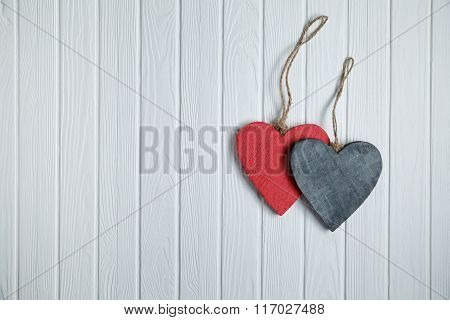 Wooden Hearts On White Wood Background