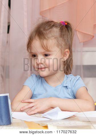 Little Girl Sitting At School Desk
