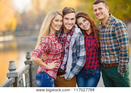 Two young couples spend time in the Park in early autumn