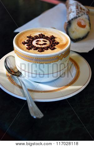 coffee cappuccino with pattern sun