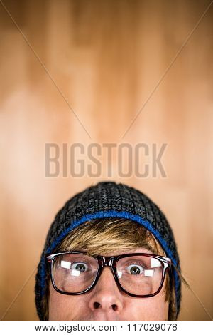 Close up of half face of hipster man staring at camera