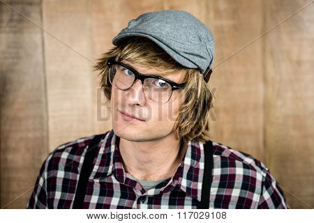 Serious blond hipster staring at camera