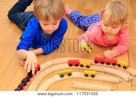 kids playing with railroad and trains indoor