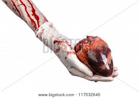 Operation And Medicine Theme: Bloody Hand Surgeon Holding A Human Heart In A Bloody White Gloves
