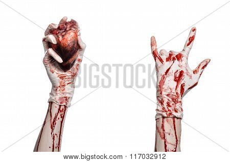 Operation And Medicine Theme: Bloody Hand Surgeon Holding A Human Heart In A Bloody White Gloves Iso