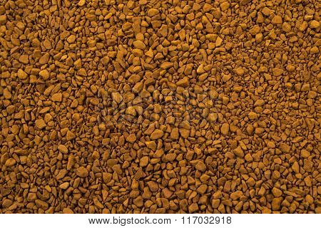 Granules of instant aromatic brown coffee background.