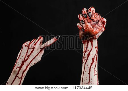 Bloody Horror And Halloween Theme: Terrible Bloody Hands With Black Nails Holding A Bloody Human Hea