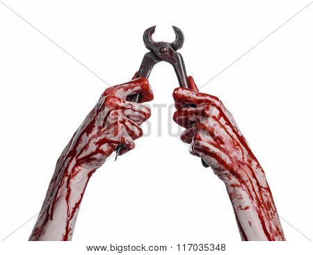 Halloween Theme: Bloody Hand Holding A Pliers On A White Background