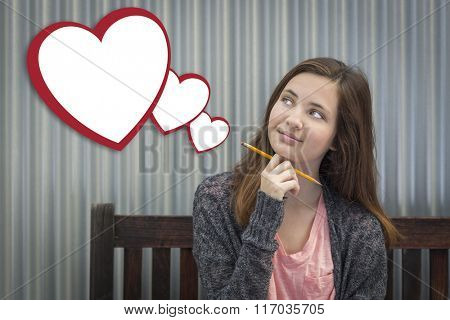 Cute Daydreaming Girl With Blank Floating Hearts Clipping Path Included.