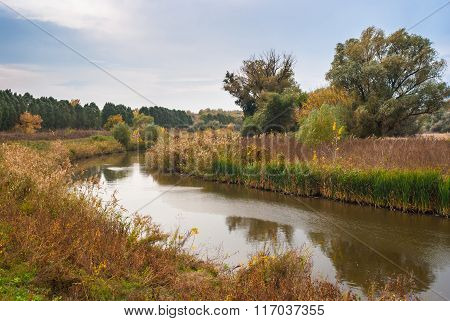 Evening landscape with small Ukrainian river Sura