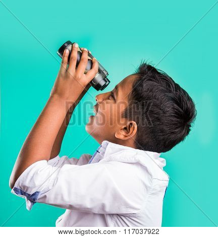 little indian kid using binoculars, little asian kid using binoculars, indian Boy with binoculars, C