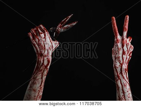 Halloween Theme: Bloody Hand Holding A Big Old Bloody Scissors On A Black Background