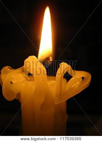 bends wax from a candle flame