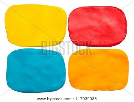 Blue, red, yellow and orange plasticine texture isolated on white background