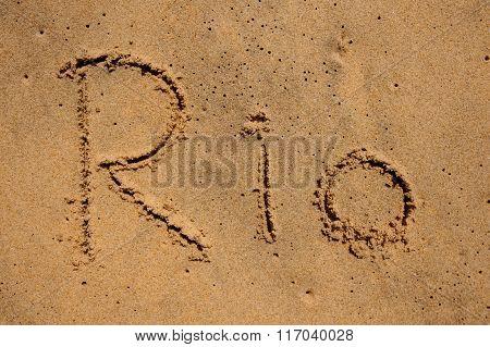 Sign Rio Written On Sand