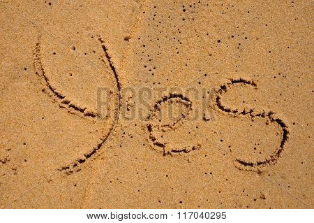 The Word Yes Is Carved On The Sand