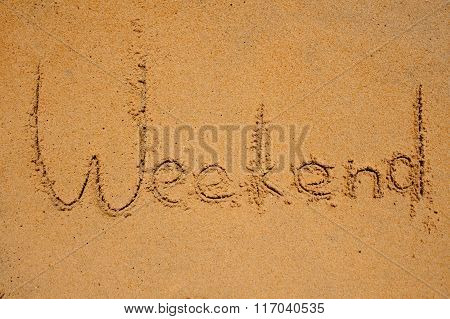 Weekend Sign Writen On Beach Sand