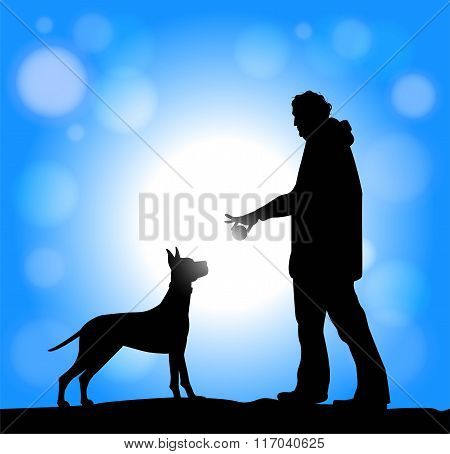 man and dog playing with a ball