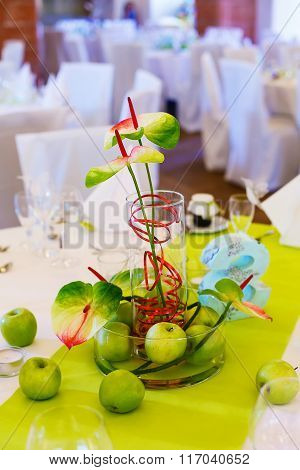 Elegant table set in white and green with apples for wedding par