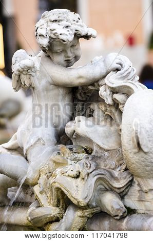 Detail of cherub in the Fountain of Neptune by Giacomo della Porta's 16th Century Piazza Navona in Rome Italy