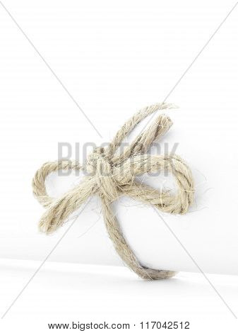 Handmade Natural Rope Knot Tied On White Paper Roll Isolated