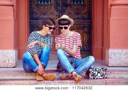 Young Male Couple Chatting Through The Mobile Device