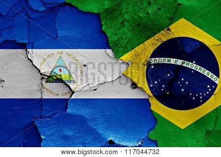Flags Of Nicaragua And Brazil Painted On Cracked Wall