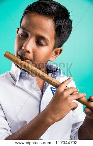 10 year old indian boy playing flute, indian boy and music, indian boy learning music, indian boy wi