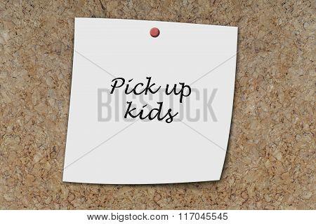 Pick Up Kids Written On A Memo