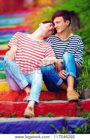 Young Male Couple On Rainbow Stairs