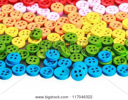 Mixed Coloured Bright Buttons Isolated On White Background