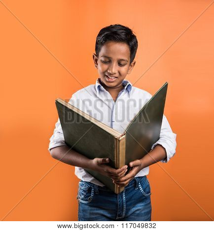 Indian kid enjoying reading book, asian kid reading book, african kid reading book, indian kid study