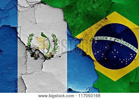 Flags Of Guatemala And Brazil Painted On Cracked Wall