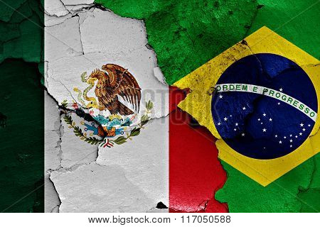 Flags Of Mexico And Brazil Painted On Cracked Wall