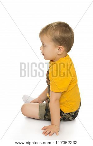 Little boy sitting on the floor