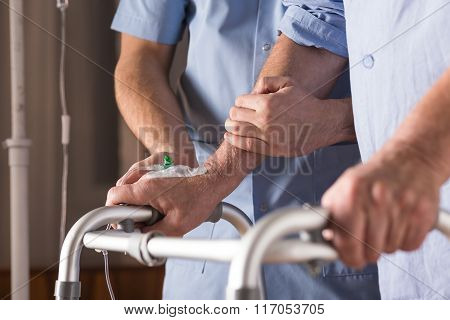 Disabled Person Walking With Assistance