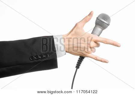 Business And Speech Topic: Man In Black Suit Holding A Gray Microphone On An Isolated White Backgrou