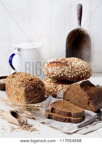 Assortment of rustic bread on wooden table background Composition with bread slices and rolls Copy s