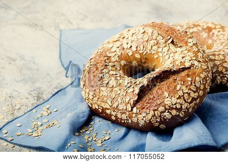 Wholegrain rye bread with seeds on blue napkin background Copy space