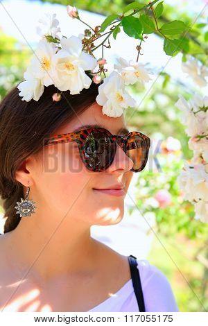 Happy Woman In The Rose Garden.