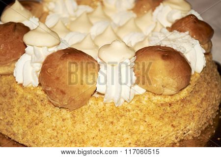 Cake With Whipped Cream And Cream Puffs