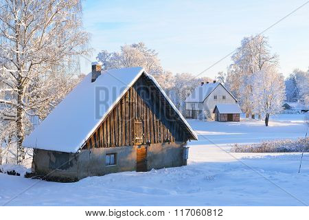 Cozy German Style Rural Cottages In Latvian Countryside On A Snowy Winter Day