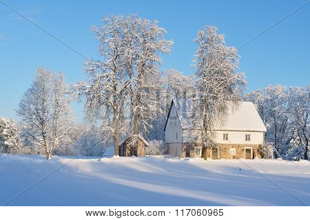 Winter Landscape With Cozy German Style Rural Cottages In Latvian Countryside On A Sunny Day