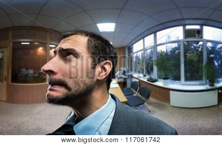 Frustrated and scared businessman in the office close up