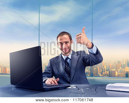Happy successful businessman smiling in the office