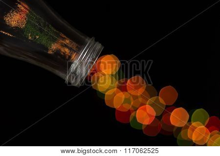 Glass Bottle Spilling Beautiful Bokeh