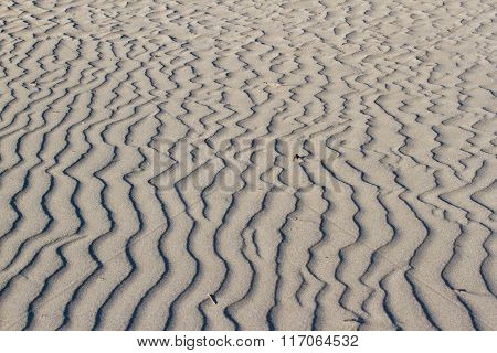Background of sand texture. Wavy texture