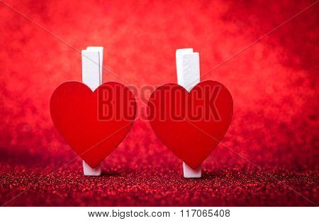 Two Hearts  Valentines Day. Defocused Glitter Background