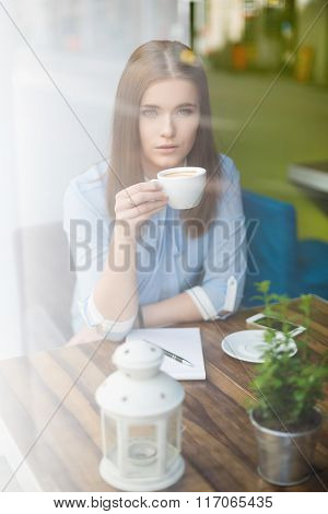 Beautiful Woman Having Coffe In Cafe