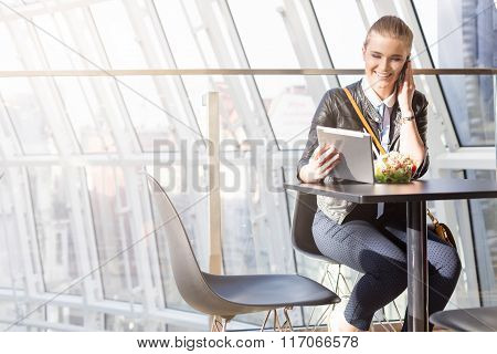 Surfing The Net In Shopping Mall During Eating A Salad